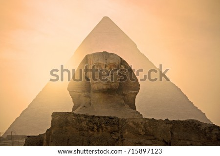 Sphinx in front of  Pyramid in Egypt. Giza pyramid complex. One of Seven Wonders of the World.