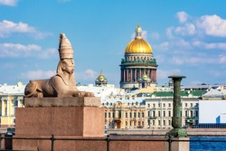 Sphinx statue on University embankment and St. Isaac's cathedral dome, Saint Petersburg, Russia (inscription