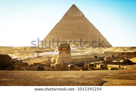 Stock Photo Sphinx with pyramids at sunset in Egypt