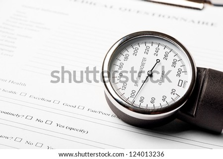 Sphygmomanometer on medical document (medical questionnaire)