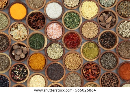 Shutterstock Spice and herb seasoning in wooden bowls forming a background on distressed white wood, high in vitamins and minerals