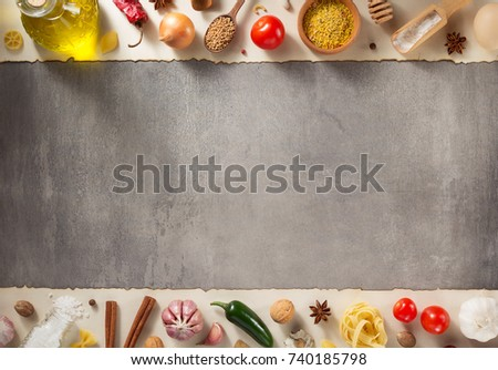 spice and herbs ingredients at stone background #740185798