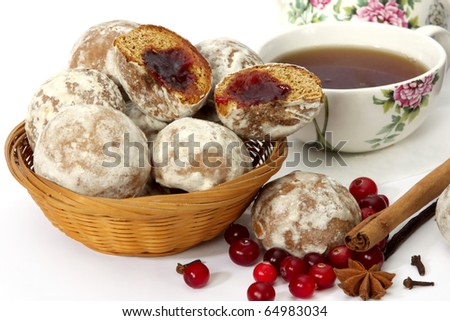 Spice-cakes, cranberry, spices and cup of tea on white background