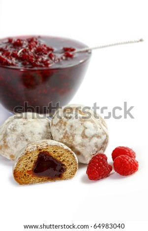 Spice-cakes with a fruit stuffing, raspberry berries and bowl with jam