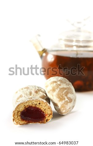 Spice-cakes with fruit stuffing for tea drinking on white background