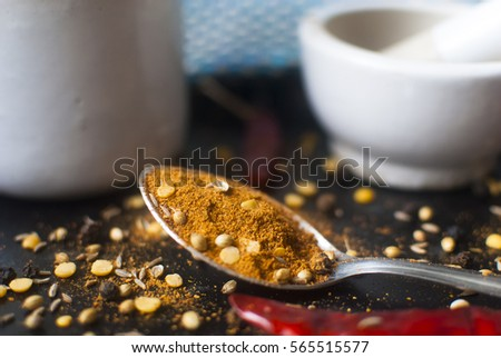 Spice Mix for making Curries. Curry Powder with red chilies, cumin seeds, coriander seeds peppercorns, and lentils with Mortar and Pestle. #565515577
