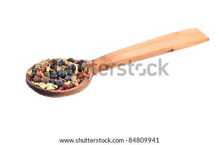 Spice mix in wooden spoon, isolated on white background