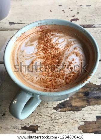 Spiced Mocha in Blue Mug at Rustic Cafe #1234890418