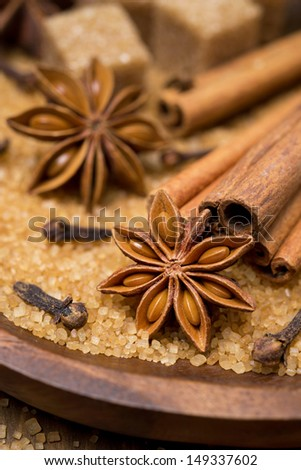 spices and brown sugar for a Christmas baking in a wooden bowl, selective focus