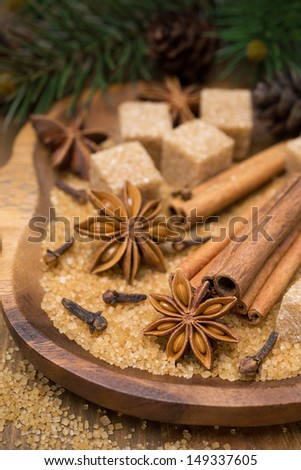 spices and brown sugar for a Christmas baking in a wooden bowl, vertical