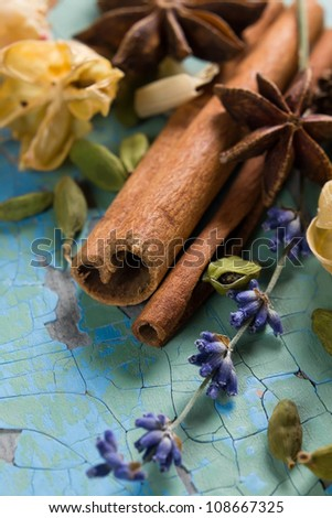 Spices and dried flowers on the vintage wooden surface