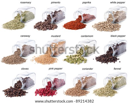 Spices and herbs are scattered on a white background from glass bottles. Lables