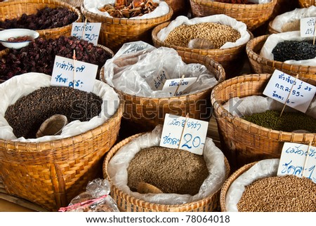 Spices and herbs in bamboo basket at market