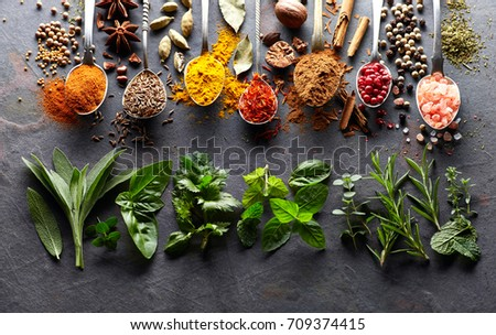 Spices and herbs on a graphite board