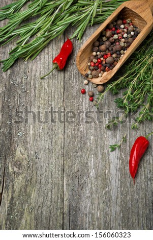 Spices and herbs on a wooden background (and space for text), vertical