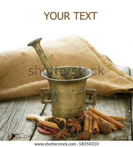 Spices and Mortar with pestle isolated on white