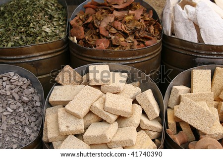 Spices and other items on the marketplace. Closest in the view is pieces of pumice stone.