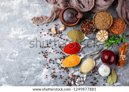 Spices and seasonings on the kitchen table on a white background #1249877881