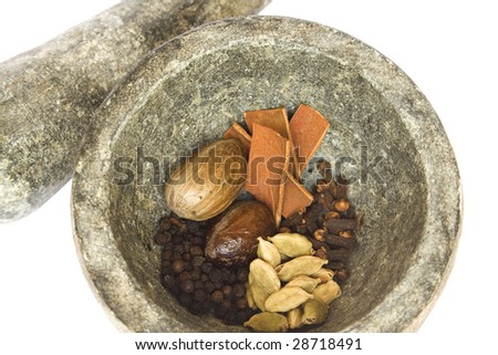 spices and stone pestle and mortar closeup isolated with clipping path