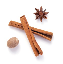 spices as cinnamon stick, anise star and nutmeg isolated on white background