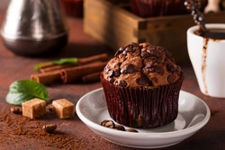 Spices, coffee and chocolate cupcakes in wooden box, close up