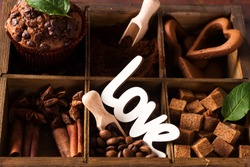 Spices, coffee and cookies in wooden box, close up