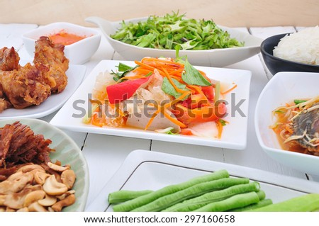 Spices food and vegetable thai food on white table.