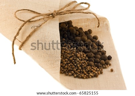 Spices: fragrant pepper, black pepper and coriander isolated on a white background
