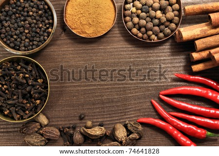 Spices frame in vintage style. Various kinds of whole spice - top shot