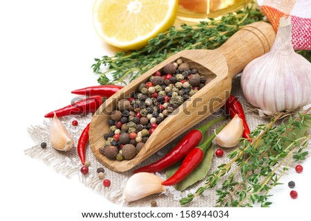spices - fresh and dried peppers, garlic, thyme and lemon isolated on white, close-up