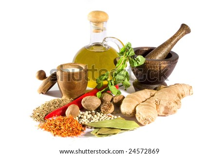 Spices, herbs, salt, olive oil and mortar with pestle isolated on white background