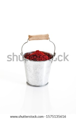 Spices in a bucket, paprika