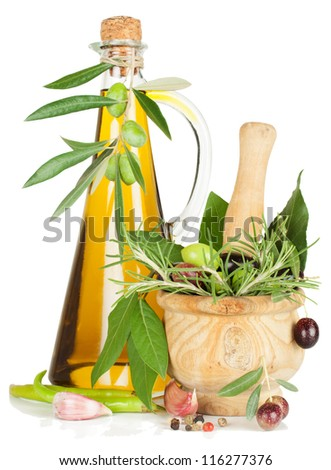 spices in a wooden mortar and olive oil,  isolated over white background.