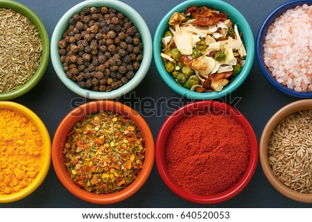 Shutterstock Spices in colorful bowls viewed from above. Various seasonings on a dark background. Italian mix, cumin, chili pepper, curry powder, Himalayan salt, pepper, garlic, cinnamon, dried tomato. Top view