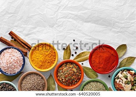 Shutterstock Spices in colorful bowls viewed from above. Various seasonings on a white background. Italian mix, cumin, chili pepper, curry powder, salt, pepper, garlic, cinnamon tomato. Top view. Copy space