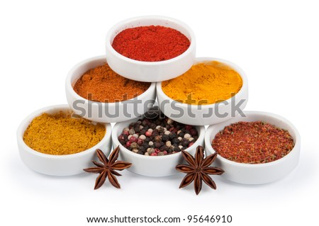 Spices in porcelain plates isolated on white background