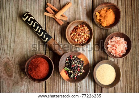 Spices in wooden bowls - stock photo