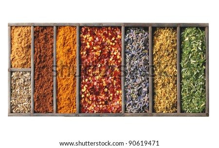 spices in wooden box isolated on white