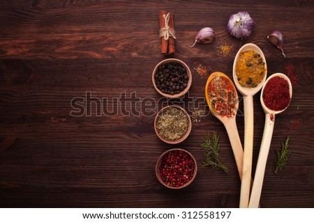 Spices of the world; spices in a wooden spoon; the substrate for the menu bars and restaurants; Cover cookbook; recipes; spicy food; Mexican cuisine; Georgian cuisine