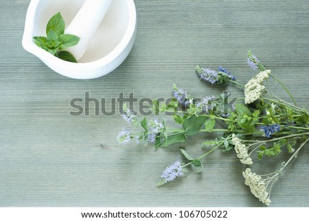 spices on table, basil in mortar, wooden background, top view