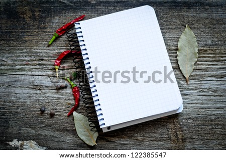 spices on wooden background and paper for notes