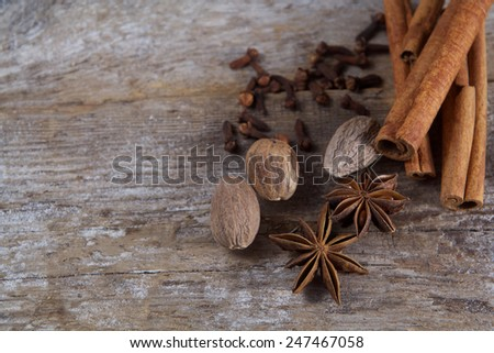Spices on wooden background. Cinnamon, nutmeg, cloves, anise