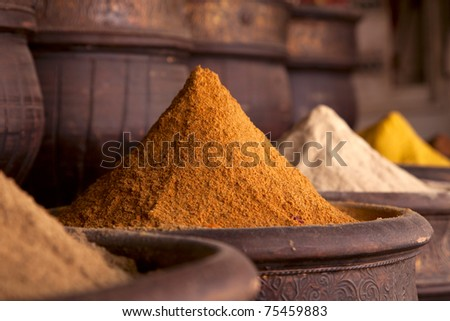 Spices pile (Curry Powder) in the  Marrakesh street shop, shallow dof