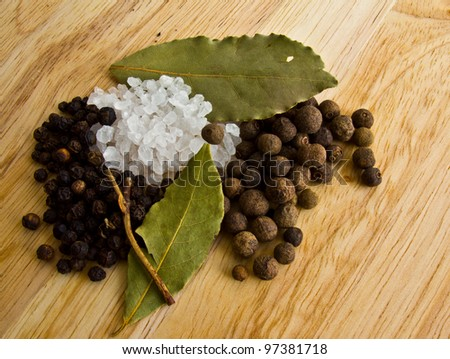 spices - salt, black, fragrant pepper and laurel leaf