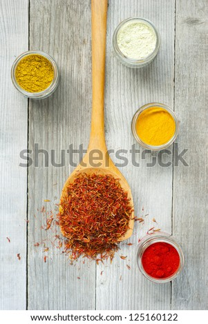spices, wooden spoon, old wood table, top view