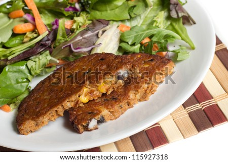 Spicy bean vegan vegetable burger with healthy salad