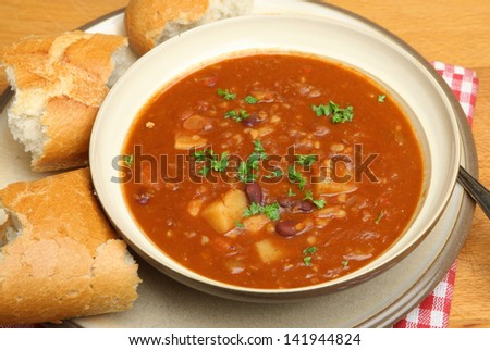 Spicy beef soup with lentils, kidney beans and chilli. - stock photo