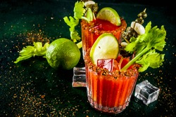 Spicy bloody mary cocktail with garnish . Homemade texmex styled alcohol drink,