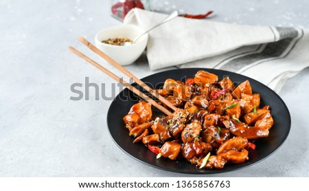 spicy chicken in sweet and sour sauce with chili pepper, Asian cuisine, Chinese cuisine, Thai cuisine, soy sauce.