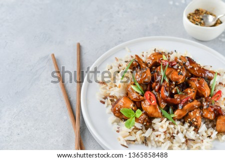 spicy chicken in sweet and sour sauce with chili pepper, Asian cuisine, Chinese cuisine. Thai cuisin. soy sauce. teriyaki chicken's  with  sesame seeds